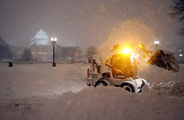 A Bobcat cleans snow from the blizzard in front of the Capitol. (Photo: Alex Brandon/AP)