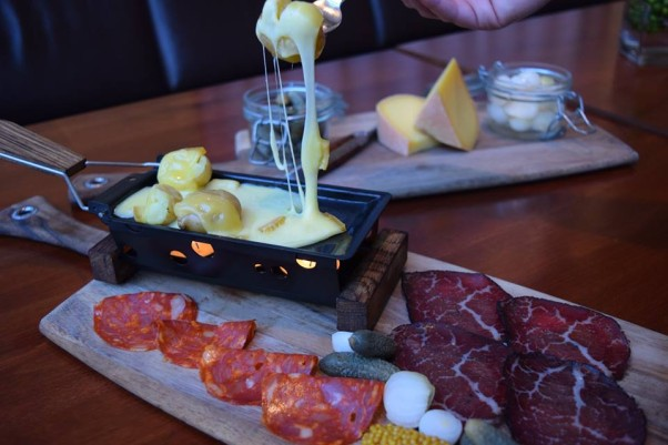The Blue Duck Tavern Lounge is now serving warm Raclette cheese over potatoes nightly starting at 6 p.m. (Photo: Blue Duck Tavern/Facebook)