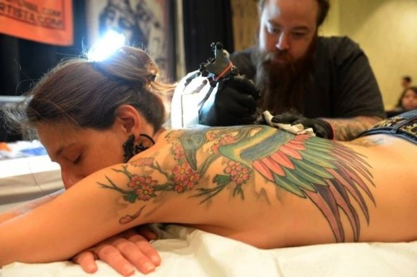 Angela Diorio of McLean has work done to her back tattoo by James Haun of Fatty's Custom Tattooz at last year's D.C. Tattoo Expo. (Photo: Jonathan Newton/The Washington Post)