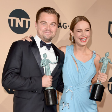 Actor Leonardo DiCaprio (left), winner of the award for Outstanding Performance by a Male Actor in a Leading Role for