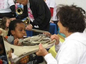 "Kids can touch and play instruments that play in an orchestra during the NSO's Day of Music's ""petting zoo.""  (Photo: Jim Pittman)"