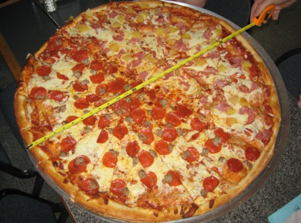 At Family Pizzeria, you and a partner can tackle a 28-inch pizza and win $20 each if you finish in an hour. (Photo: Family Pizzeria)