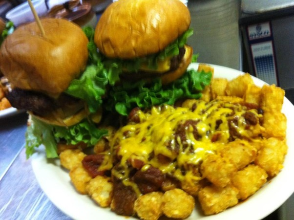 Finish two Fat Boy burgers and pound of tater tots in under an hour and you win a T-shirt, but still have to pay for your meal. (Photo: Hamilton's Bar & Grill/Facebook)