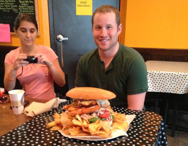 A contestant about to tackle Bub & Pap's Li'l Petey Sandwich Challenge. (Photo: Bub & Pop's Sandwich Shop)