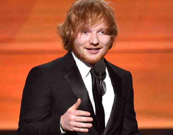 Ed Sheeran accepts one of his Grammys. (Photo: Kevin Winter/WireImage)