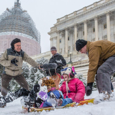 Sledders slide down the hill in front of the U.S. Capitol Building. (Photo: Joseph Gruber)