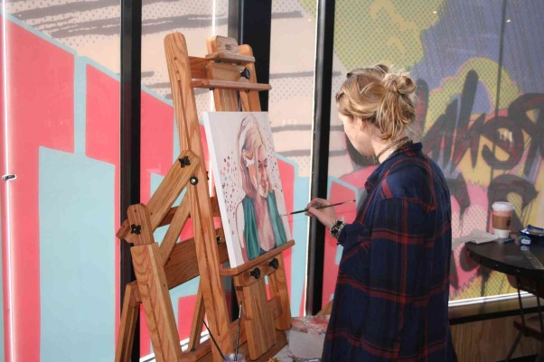 Artist Lizzy Lunday works on a portrait at Palette 22 last Wednesday. (Photo: Mark Heckathorn/DC on Heels)