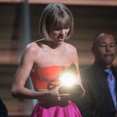 Taylor Swift accepts the Album of the Year Grammy. (Photo: Kevork Djansezian/WireImage)