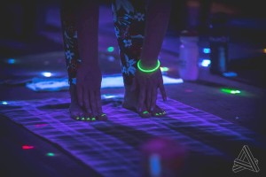 Practice your sun poses in the dark with this black-light themed yoga session (Photo: Grip The Mat)