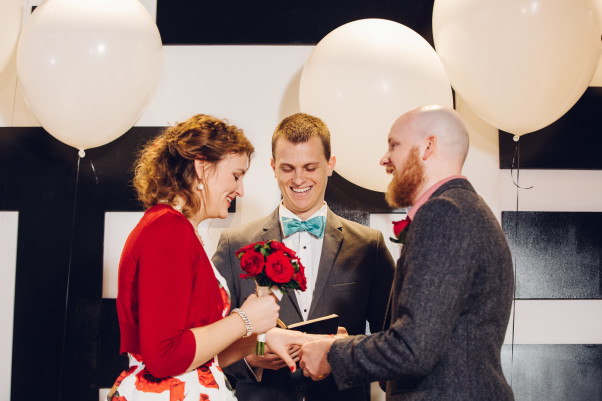 A couple exchanges vows during their wedding at &pizza in Columbia Heights. (Photo:  Rachel Couch for Pop! Wed Co.)