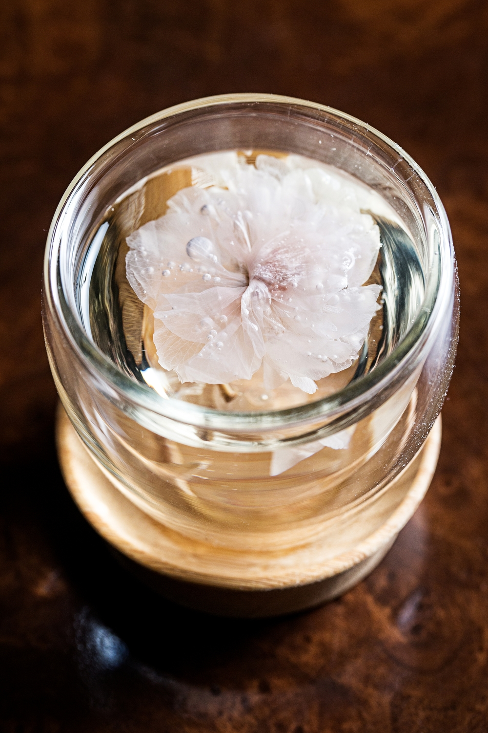 The Columbia Room's cocktail menu includes Cherry Blossom Tea with a pickled cherry-blossom flower suspended in a glass of malty Mizu shochu and apricot liqueur. (Photo: Columbia Room)