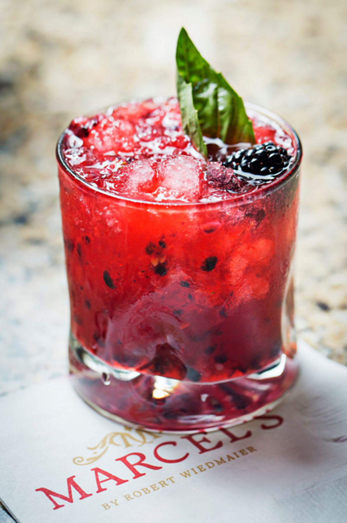 Marcel's has a Cherry-Berry Caipirinha, made with house-made cherry-ginger syrup and cherry-blackberry-basil shrub, Cachaça, lime and sugar. (Photo: Marcel's)