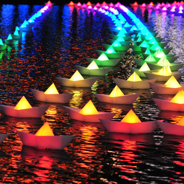 "Three hundred floating ""paper boats"" with colored LED lights will fill Inner Harbor's water between Piers 5 and 6. (Photo: Light City)"