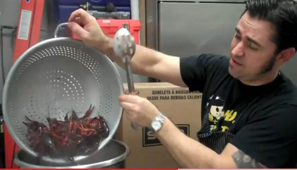 Chef David Guas cooks crawfish for Bayou Bakery's crawfish boil. (Photo: Bayou Bakery, Coffee Bar & Eatery)