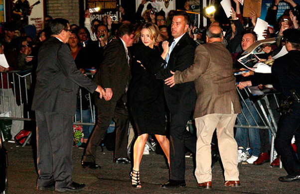 Body guards help actress Jennifer Lawrence Jennifer when a barrier broke as she was signing autographs outside the Ed Sullivan Theatre. (Photo: Wenn/HRC)