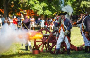 Revolutionary War reenactors fire a cannon at Mount Vernon. (Photo: Grace Darnell)