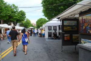 Visitors check out the art for sale at the Bethesda Fine Arts Festival. (Photo: Bethesda Urban Partnership)