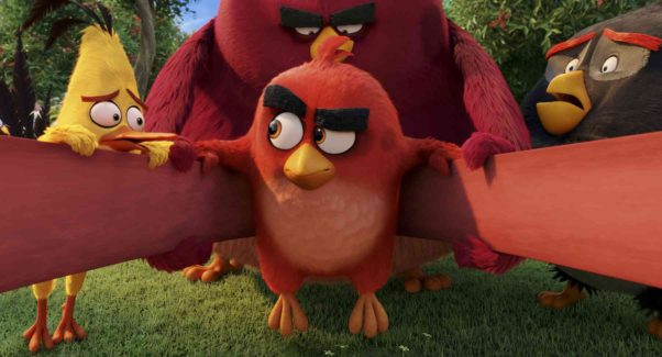 Red (Jason Sudeikis) in the slingshot with Chuck (Josh Gad), Terence and Bomb (Danny McBride) looking on. (Photo: Rovio Animation)