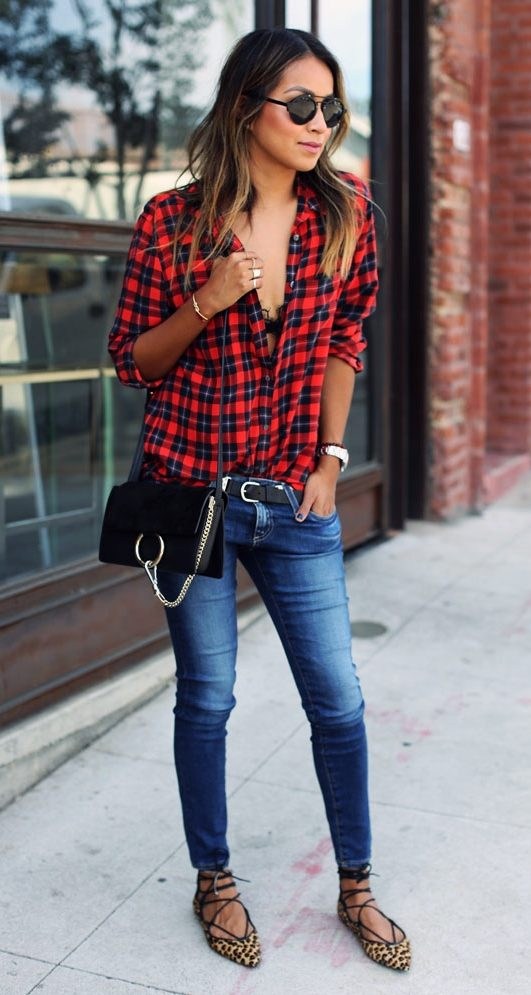 Wear his flannel shirt with jeans or over a plain dress. (Photo: Sincerely Jules)