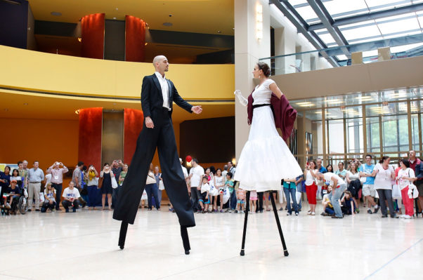 Dancers on stilts perform at the Italian Embassy during the EU embassies open house day. (Photo: Yuri Gripas)