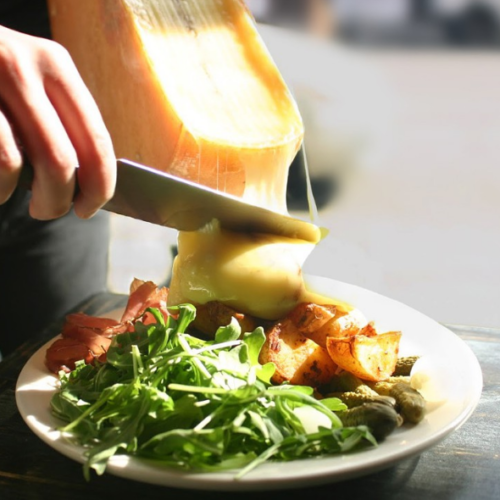 Brasserie Beck is offering free melted Raclette on pee wee potatoes and gherkins during happy hour. (Photo: Brasserie Beck)