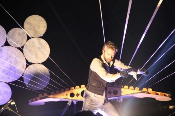 William Close plays an earth harp, two of which have been strung from the walls and ceiling of the Kennedy Center's Hall of States for Ireland 100. (Photo: Kennedy Center)