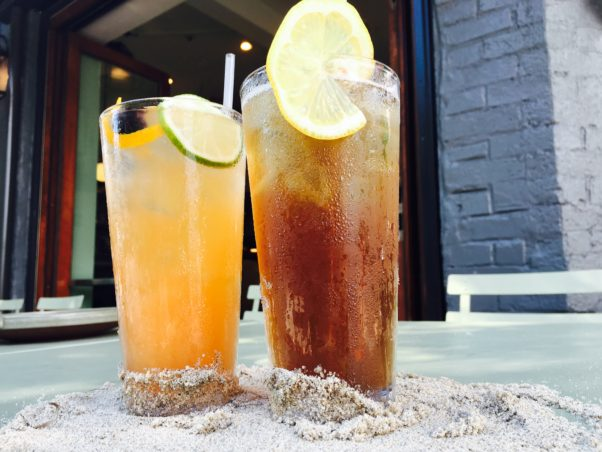 The Royal will offer beachy eats and drinks like the Shah Sling (left) and the LeDroit Iced Tea at it's June Royal Nights. (Photo: The Royal)