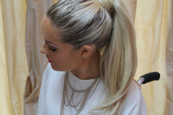 A high pony is a modern, chic take on a classic look. (Photo: Jordan's Beautiful Life)