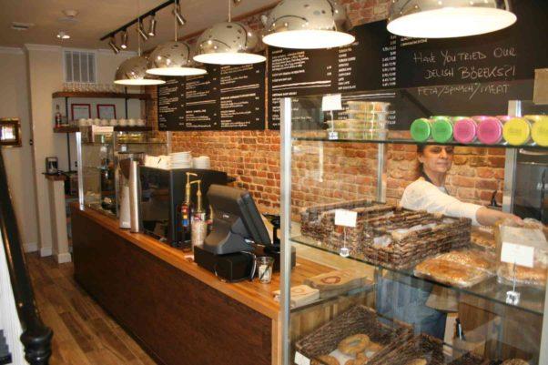 Co-owner Zeynep Kocabal serves a customer from the bakery case. (Photo: Mark Heckathorn/DC on Heels)