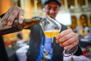 A craft beer representative pours at beer at last year's Savor. (Photo: Brewers Association)