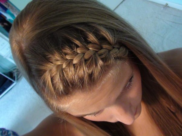 A French braid head band is great for getting your hair out of your face. (Photo: YouTube)
