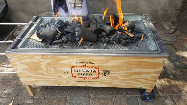 El Centro D.F. in Georgetown will prepare a whole roast pig on this La Caja China on Sunday night. (Photo; El Centro D.F.)