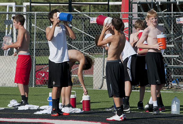 When participating in summer football practice, players should complete an acclimation period to get used to playing in the heat. (Photo: Daniel Friedman)