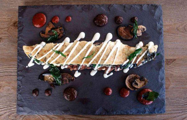 El machete is a N,Y. grilled strip with corn tortilla, Oaxaca cheese, epazote, mushroom, truffle oil, pasilla salsa and guajillo salsa. (Photo: Richard Sandoval Restaurants)