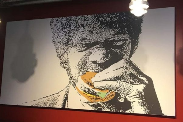 "A portrait of Samuel L. Jackson eating a Tasty Burger in ""Pulp Fiction"" hangs in the restaurant. (Photo: Borderstan)"