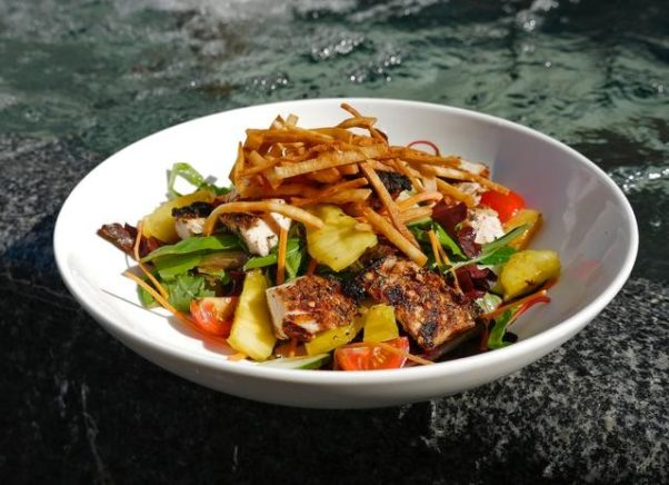 Ocean Blue's grilled jerk chicken salad  with jerk chicken, mixed greens, grilled pineapple and tortilla strips with lime vinaigrette is $12.50. (Photo: Ocean Blue)