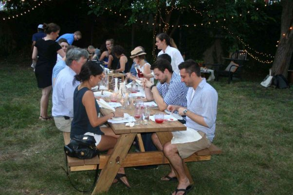 Diners sit down at the first al fresco Poppy's Pop-Up dinner in Eckington. (Photo: Mark Heckathorn/DC on Heels)