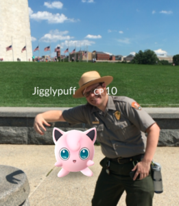 A park ranger poses with a Jigglypuff in front of the Washington Monument. (Photo: National Mall and Memorial Parks)