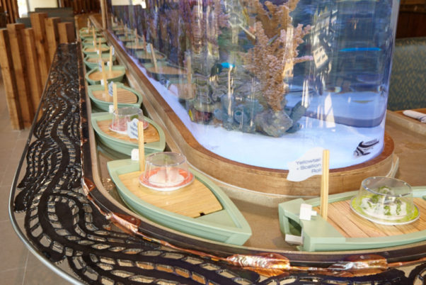 Ocean Blue in Sterling features two 3,000-gallon aquariums and a canal filled with skiffs that serve diners their sushi. (Photo: Jeff Elkins)