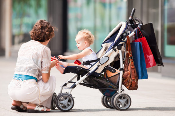 Heavy items should be stored under a stroller or carried, not hung from the handles, to keep the carrier from tipping over. (Photo: iStock)