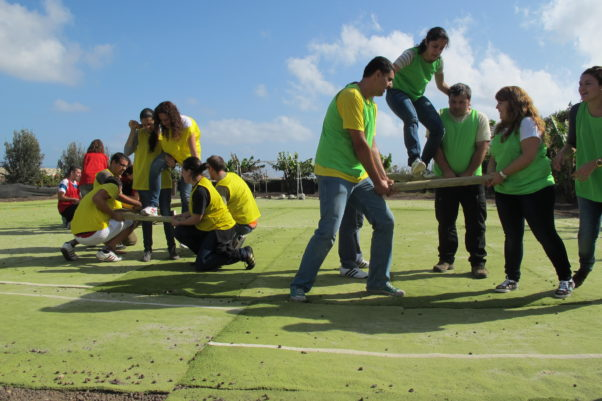 Team building can bolster team spirit and improve unity. (Photo: Wikipedia)
