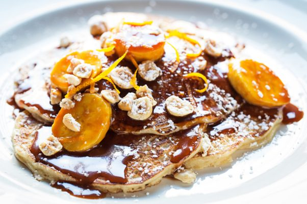 Cassolare in the Glover Park Hotel is now serving lunch and breakfast, including buttermilk pancakes with caramelized bananas, orange zest and crushed hazelnuts. (Photo: Scott Suchman)