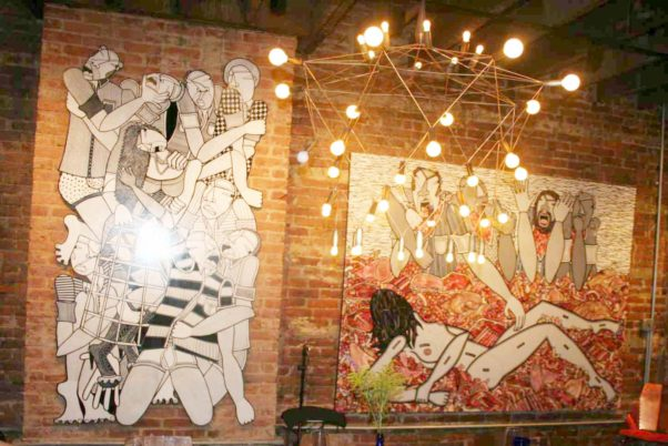 Artwork from Swedish-born local artist Anna U. Smith fills the walls of Dacha Loft. (Photo: Mark Heckathorn/DC on Heels)