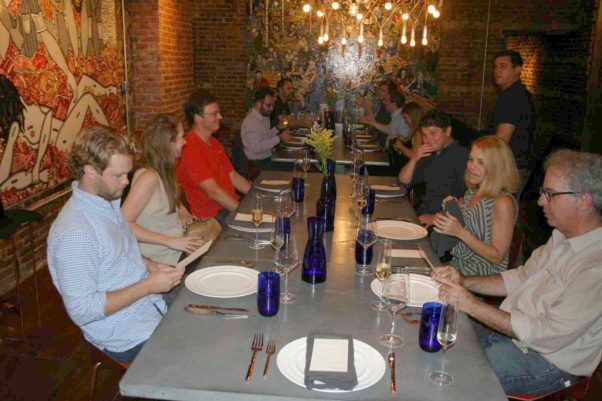 Chef Quinten Frye (standing far right) talks with diners during last week's Dacha Supper Club. (Photo: Mark Heckathorn/DC on Heels)