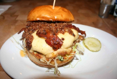 The Big Pig with an andouille and beef blended patty is topped with Applewood smoked bacon, lettuce, bacon onion jam, smoked mozzarella and garlic mayo. (Photo: Mark Heckathorn/DC on Heels)