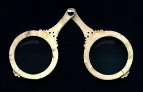 Early spectacles were two round lenses fixed by a hinge that came to a point above the nose and held on by ribbon or cord tied around the ears. (Photo: Muslim Heritage Images)