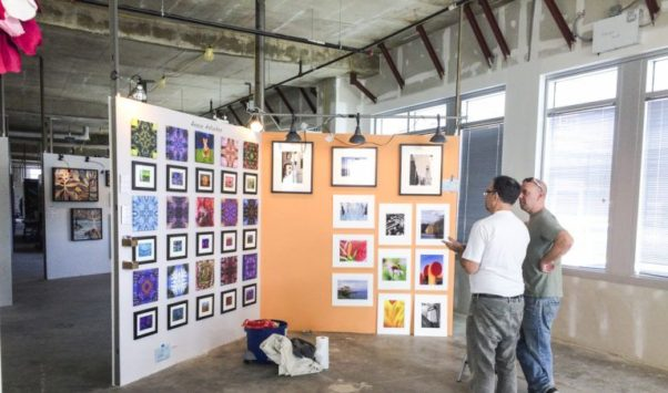 Artists finish hanging their work for this year's Artomatic in Potomac. (Photo: Artomatic)