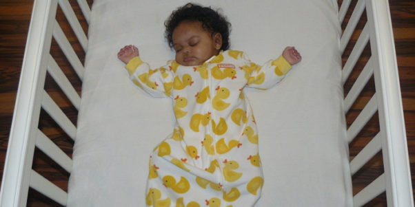 The American Academy of Pediatrics recommends that infants sleep flat on their backs on a thin mattress with nothing and no one else on the surface other than the clothing the baby is wearing. (Photo: Thinkstock)