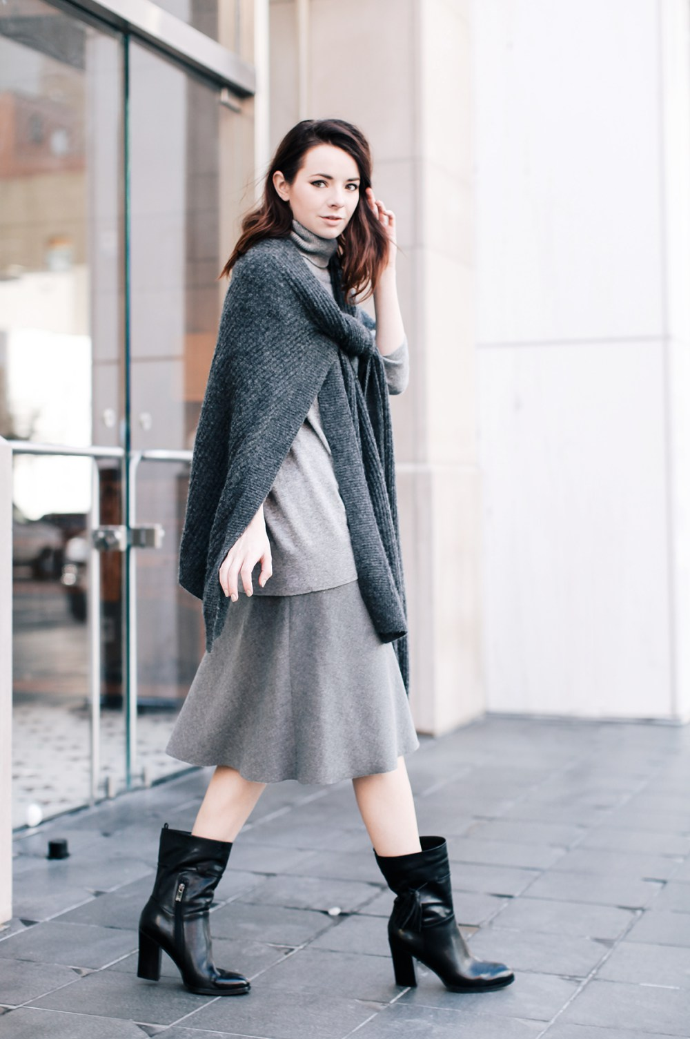 Leather ankle boots help to break up the gray coordinates. (Photo: Sea of Shoes)