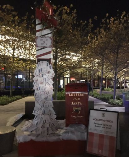 A tower built with letters to Santa is one of eight displays featuring mistletoe at Yards Park this holiday season. (Photo: Spicy Candy)